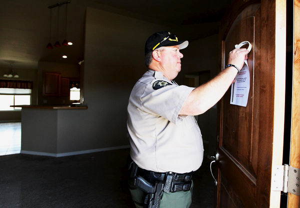 Sheriff serving eviction writ